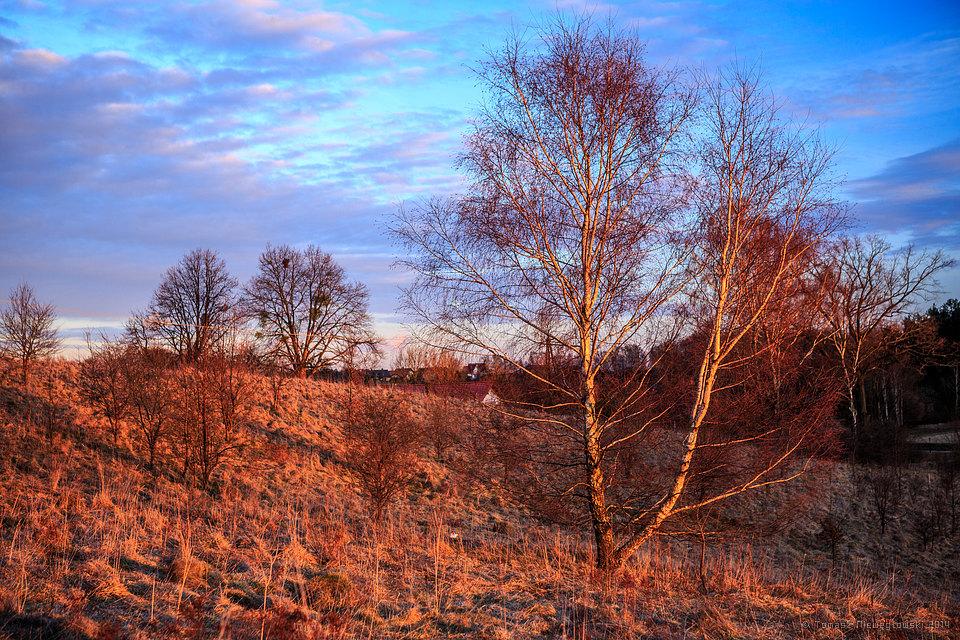 Pejzaż warmiński wczesną wiosną, zachód słońca